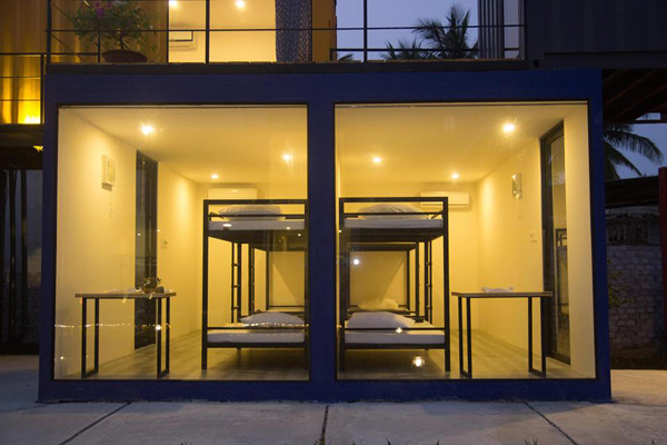 The hostel boasts rooms with glass panels, allowing tourists to enjoy the view and catch some sunlight.